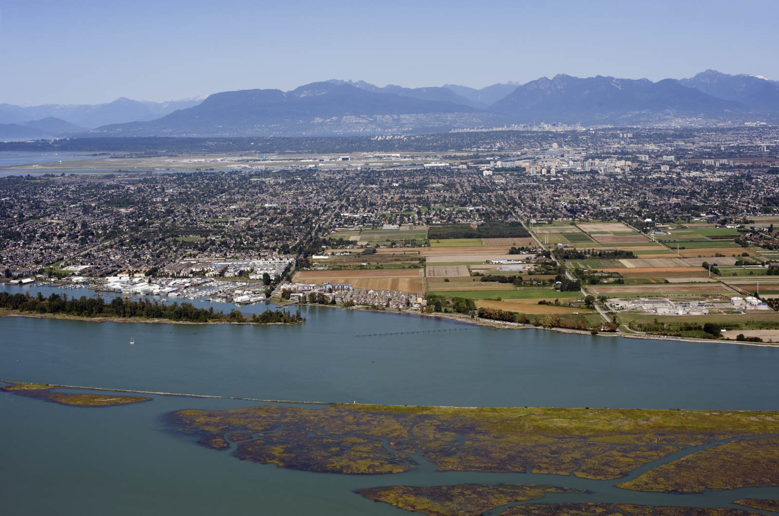 An aerial view of the Richmond Area, showing the river and the mountains in the distance